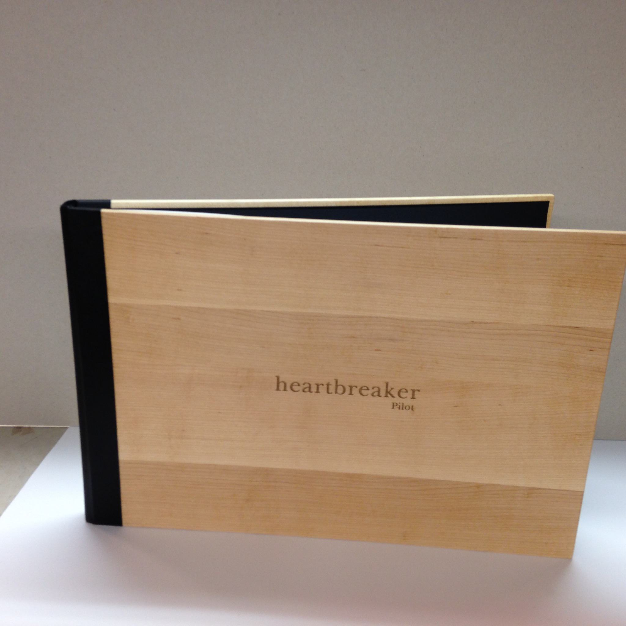 Sample of wood and leather binding